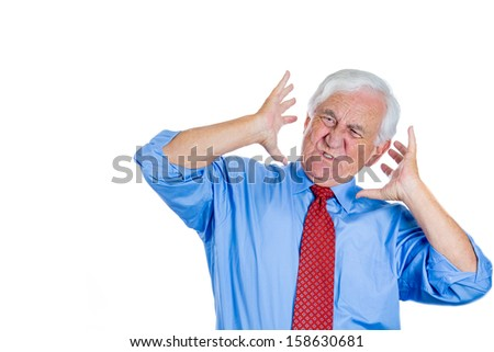 Closeup portrait of an elderly mad executive, boss, man covering his ears looking up, as if to say, stop making that loud noise it's giving me a headache, isolated on white background with copy space - stock photo