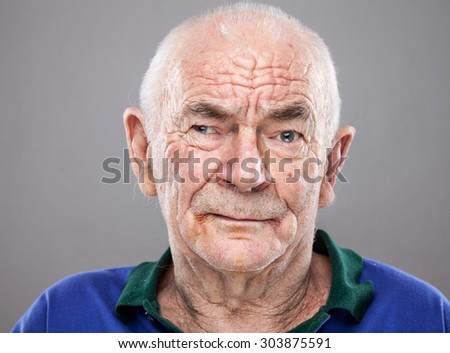 Closeup portrait of an elderly man - stock photo