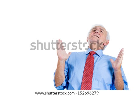 Closeup portrait of an elderly, senior man with white hair , looking upwards and praying and asking for a miracle, isolated on white background with copy space