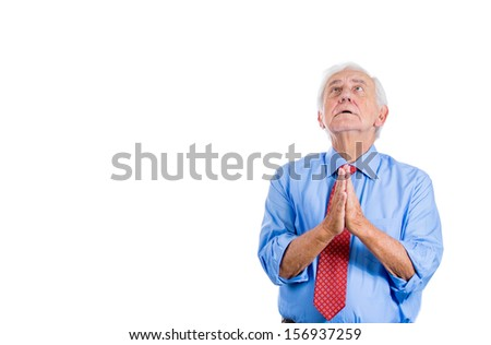 Closeup portrait of an elderly, senior sad man with white hair, looking upwards and praying and asking for a miracle or forgiveness, isolated on white background with copy space - stock photo