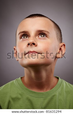Closeup portrait of an European child looking up - stock photo