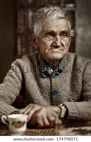 Closeup portrait of an expressive old man in his 80s - stock photo