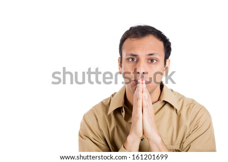 Closeup portrait of an handsome man in brown shirt, looking upwards to sky with hands clasped praying asking for a miracle or sign, isolated on white background with copy space. Positive human emotion