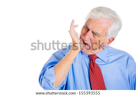 Closeup portrait of an old man executive, boss, grandfather, manager, wearing blue shirt with tooth ache or something stuck in his teeth, isolated on a white background with copy space - stock photo