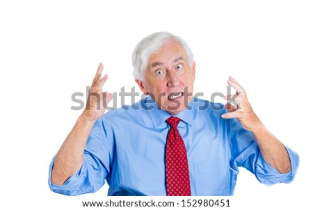Closeup portrait of an unhappy senior man, executive, grandpa, having an argument with someone and trying to prove opponent is wrong , Isolated on white background. Conflict resolution. - stock photo