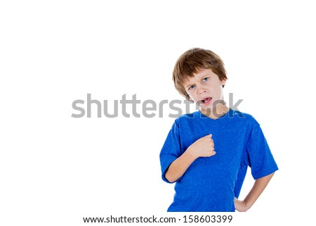 Closeup portrait of angry adorable kid pointing at self as if to say you mean me, are you talking to me?, isolated on white background with copy space. Negative human emotions facial expressions