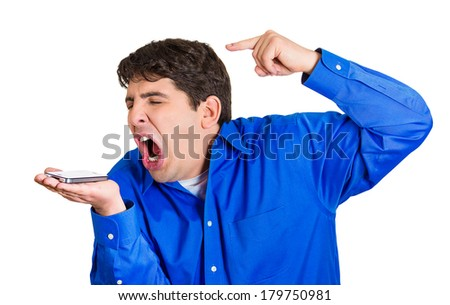 Closeup portrait of angry, annoyed young man, guy, student, mad worker, pissed off employee shouting while on phone, isolated on white background. Negative human emotions, facial expressions, feelings - stock photo