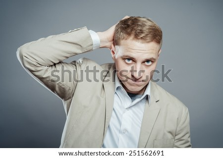 Closeup portrait of angry, frustrated man, hand on head. Negative human emotions and facial expressions - stock photo