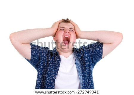 Closeup portrait of angry, frustrated man, pulling his hair out, isolated on white background with copy space. Negative emotions - stock photo