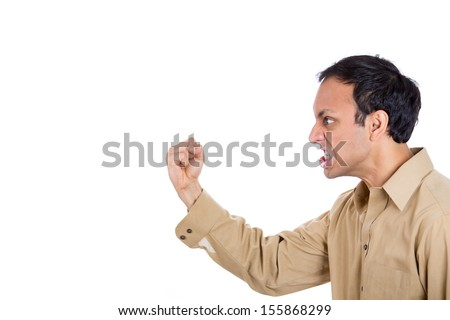 Closeup portrait of angry man screaming, with fist in air, isolated on white background with copy space