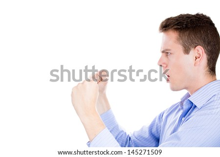 Closeup portrait of angry man screaming, with fists in air, isolated on white background with copy space to left - stock photo