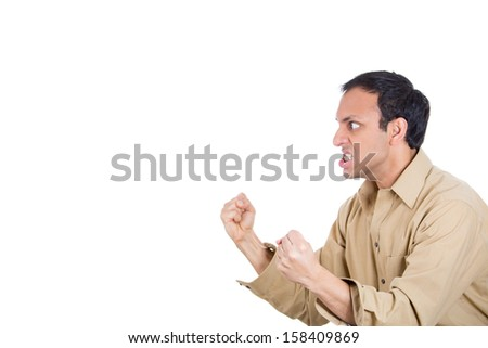 Closeup portrait of angry man screaming, with fists in air, isolated on white background with copy space - stock photo