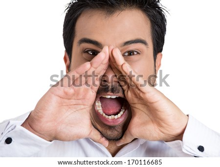 Closeup portrait of angry pissed off irritated guy placing hands to open mouth, screaming, shouting, yelling looking mad angry isolated on white background. Negative emotion facial expression feeling