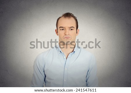 Closeup portrait of angry sad annoyed skeptical, grumpy business man upset employee worker isolated grey wall background. Human emotions face expression reaction interpersonal conflict resolution - stock photo