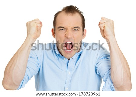 Closeup portrait of angry upset young man, worker, mad employee, funny looking business man, fist in air, open mouth yelling, isolated on white background. Negative emotion facial expression, reaction