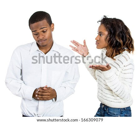 Closeup portrait of angry woman hands up at sad man blaming and saying bad boy because he did something wrong, isolated on white background. Negative emotion facial expression feeling  - stock photo
