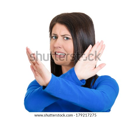 Closeup portrait of angry young woman with X gesture to stop talking, cut it out, dont go there, isolated on white background. Negative emotion facial expression feelings, signs symbols, body language - stock photo