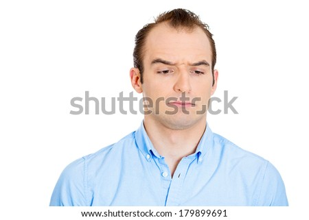 Closeup portrait of annoyed, grumpy business man, employee, worker looking suspicious, isolated on white background. Human emotions, face expressions, reaction, interpersonal conflict resolution - stock photo