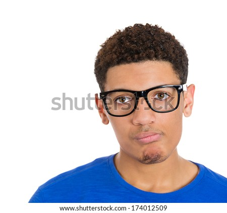 Closeup portrait of annoyed sad skeptical, unhappy young man, student bothered by parents, teacher, coach, isolated on white background. Negative human emotions, facial expressions, attitude, reaction - stock photo