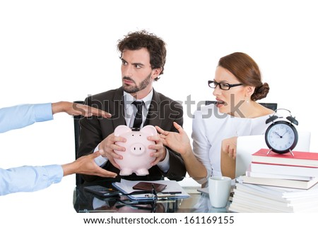 Closeup portrait of anxious, shocked, unhappy, stressed, worried young couple, man and woman holding piggy bank, looking scared, protecting savings from being stolen, isolated on white background.  - stock photo