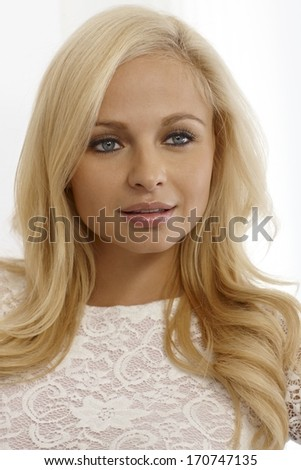 Closeup portrait of attractive blonde woman, looking away.