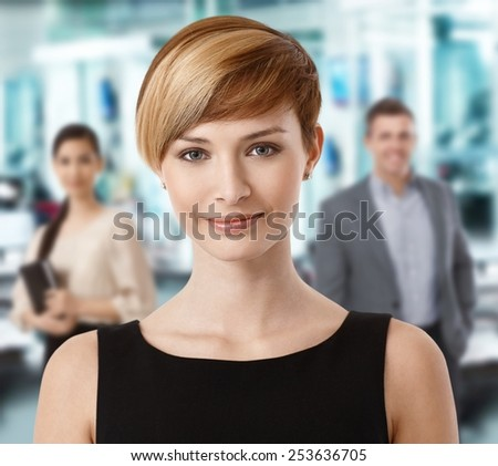 Closeup portrait of attractive businesswoman in office. - stock photo