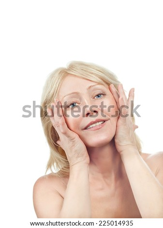 closeup portrait of attractive  caucasian smiling old mature riffles woman brunette isolated on white studio shot lips toothy smile face hair head and shoulders looking at camera tooth - stock photo
