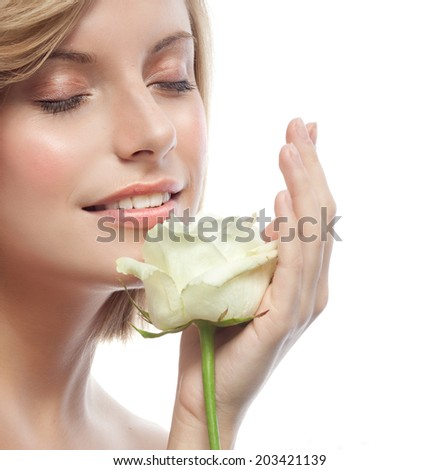 closeup portrait of attractive  caucasian smiling woman blond isolated on white studio shot lips toothy smile face  head  eyes closed white rose flower aroma - stock photo