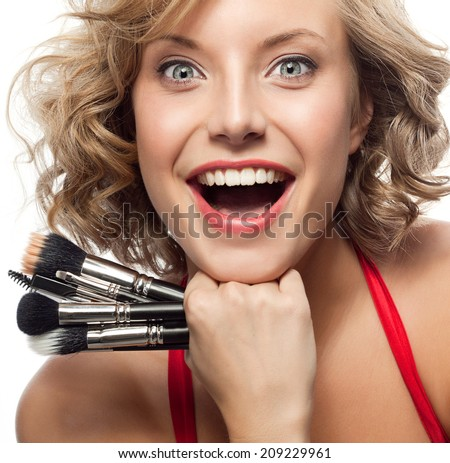 closeup portrait of attractive  caucasian smiling woman blond isolated on white studio shot lips toothy smile face hair head and shoulders looking at camera blue eyes tooth brush makeup - stock photo