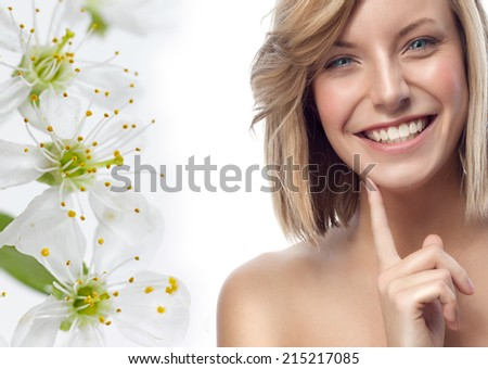 closeup portrait of attractive  caucasian smiling woman blond isolated on white studio shot lips toothy smile face hair head and shoulders looking at camera blue eyes tooth flowers spring aroma - stock photo