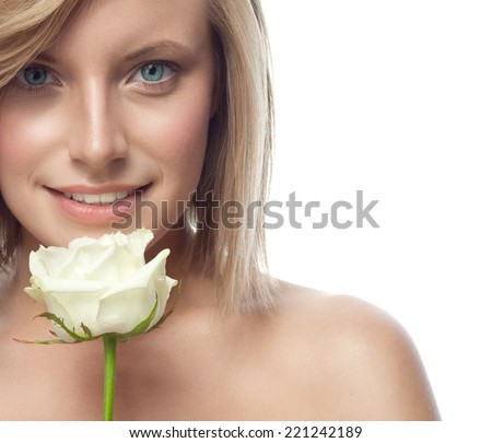 closeup portrait of attractive  caucasian smiling woman blond isolated on white studio shot lips toothy smile face hair head and shoulders looking at camera blue eyes flower rose aroma - stock photo