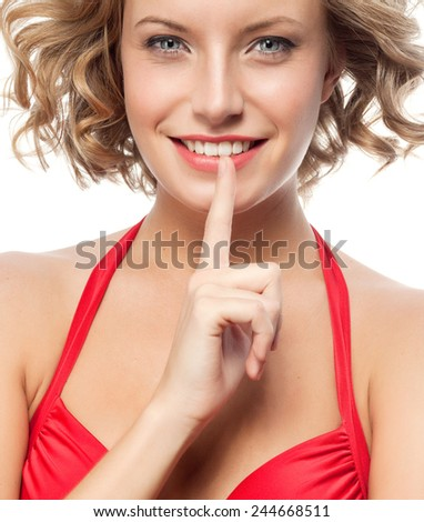 closeup portrait of attractive  caucasian smiling woman blond isolated on white studio shot lips toothy smile face hair head and shoulders looking at camera blue eyes tooth secret - stock photo
