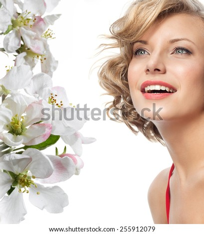 closeup portrait of attractive  caucasian smiling woman blond isolated on white studio shot lips toothy smile face hair head and shoulders looking up blue eyes tooth spring flowers - stock photo