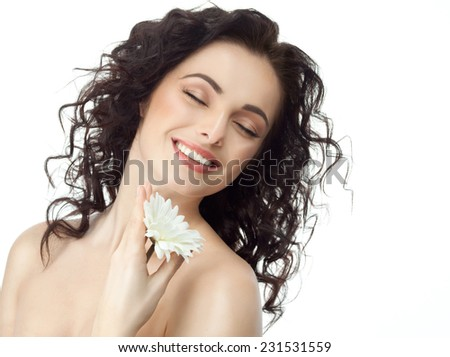 closeup portrait of attractive  caucasian smiling woman brunette isolated on white studio shot lips toothy smile face hair head and shoulders eyes closed tooth flower - stock photo