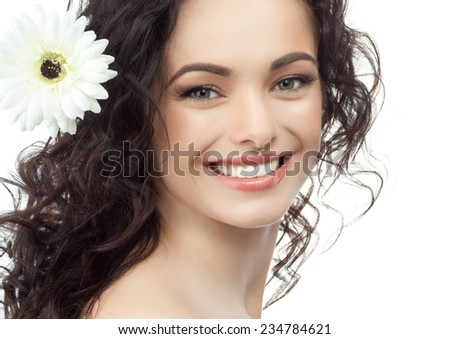 closeup portrait of attractive  caucasian smiling woman brunette isolated on white studio shot lips toothy smile face hair head and shoulders looking at camera tooth flower - stock photo