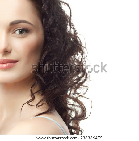 closeup portrait of attractive  caucasian smiling woman brunette isolated on white studio shot lips  face hair head and shoulders looking at camera