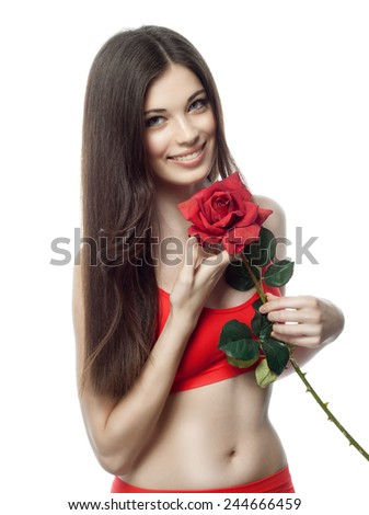 closeup portrait of attractive  caucasian smiling woman brunette isolated on white studio shot lips toothy smile face hair head and shoulders looking at camera tooth red rose flower body - stock photo