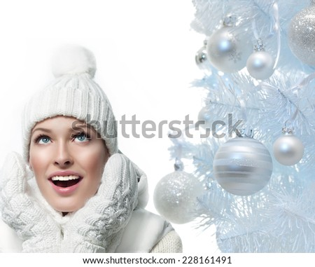 closeup portrait of attractive  caucasian smiling woman in warm clothing - stock photo