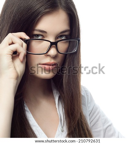 closeup portrait of attractive  caucasian  woman brunette isolated on white studio shot lips  face hair head and shoulders looking at camera glasses businesswoman