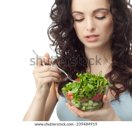 closeup portrait of attractive  caucasian  woman brunette isolated on white studio shot lips  face hair head and shoulders eating salad - stock photo