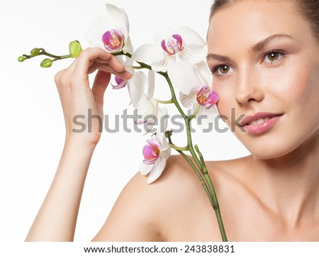 closeup portrait of attractive  caucasian  woman brunette isolated on white studio shot lips  face  head and shoulders flower - stock photo