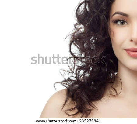 closeup portrait of attractive  caucasian woman brunette isolated on white studio shot lips toothy smile face hair head and shoulders looking at camera