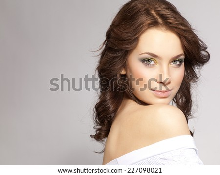 closeup portrait of attractive  caucasian  woman brunette  studio shot lips face hair head and shoulders looking at camera skin - stock photo