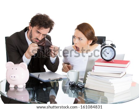Closeup portrait of attractive couple, man and woman, looking distressed from financial problems and mounting bills, holding an empty wallet, isolated on white background. Bad financial decisions. - stock photo