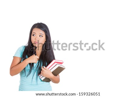 Closeup portrait of attractive cute woman carrying books in one arm, and wondering about something worrisome with black glasses on chin, isolated on white background with copy space