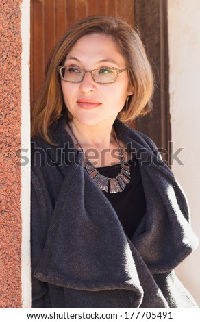 Closeup portrait of attractive middle aged woman - stock photo