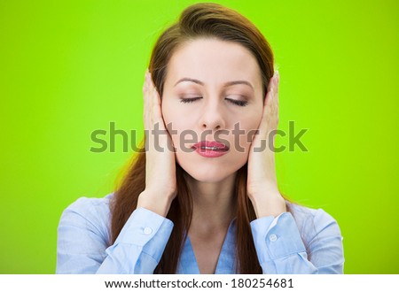 Closeup portrait of attractive, peaceful, looking relaxed young woman, covering ears, closing her eyes, isolated on green background. Hear no evil concept. Human emotions, facial expression, attitude - stock photo