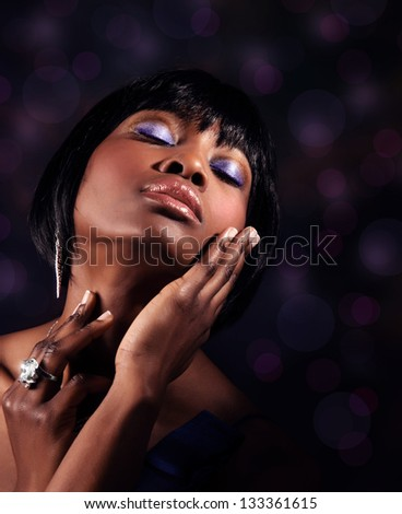 Closeup portrait of attractive sensual black woman with perfect makeup, luxury beauty salon - stock photo