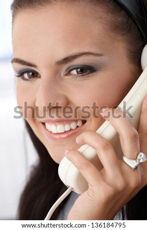 Closeup portrait of attractive smiling woman on phone call. - stock photo
