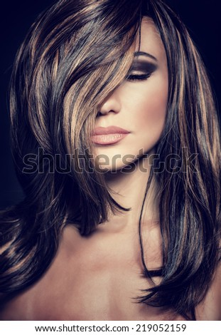 Closeup portrait of attractive supermodel with sexy stylish makeup and healthy shiny hair, seductive female on luxury photo shoot